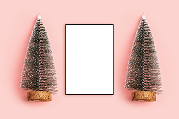 Christmas composition. Photo frame, pine christmas tree on pastel pink background top view, copy space two