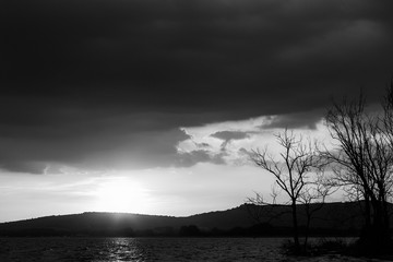 Trasimeno lake (Umbria, Italy) with big clouds at sunset