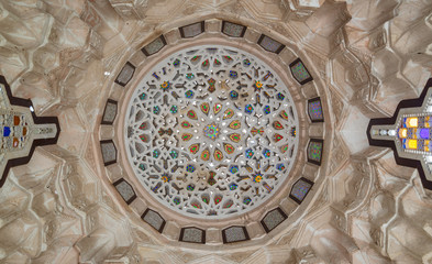 Ottoman era carved plaster dome decorated with colored glass pieces of a pergola in front of El sehemy historical house, El Moez street, Cairo, Egypt