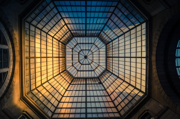 Glass and iron patterned ceiling roof of huge dome view from below Wall mural