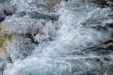 Printed kitchen splashbacks River Powerful flow of water over the stones, mountain river close up.