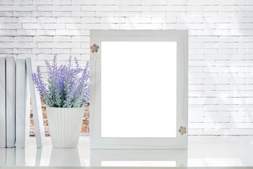 Mock up white wooden frame with blank page and houseplant on white table and white brick wall background