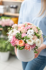floral bunch in head box. European floral shop. Bouquet of beautiful Mixed flowers in woman hand. Excellent garden flowers in the arrangement , the work of a professional florist.