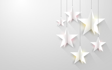 Paper art. White stars hanging on strings