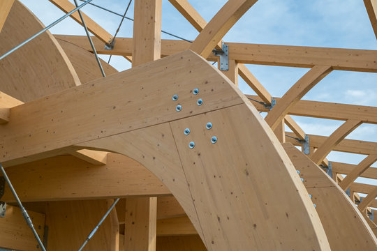 Detail of a modern wooden architecture in glued laminated timber