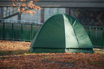 closeup of homeless in igloo tent in urban park