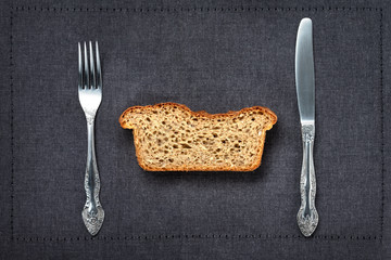 whole grain or whole wheat bread, slices of homemade bread. Flat lay. Food concept with fork and knife