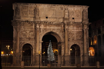 Arch of Constantine by night in Christmas time in Rome, Italy