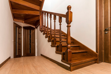 Papiers peints Escalier Modern brown oak wooden stairs and doors in new renovated house interior