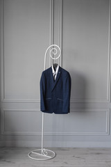 classic men's jacket on the hanger on a white background suit and shoes designer men's jacket with a white shirt showcase for men's store men's suit and shoes
