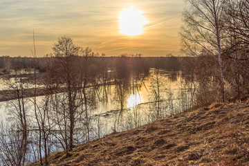 Rural spill in the central zone of Russia at sunset