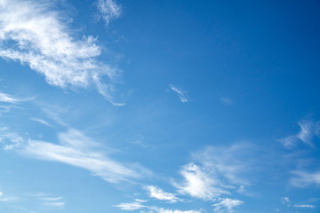 Blue sky and white puffy clouds.
