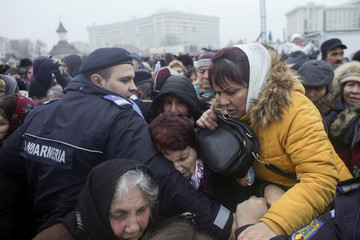 People try to get past riot police and enter the newly consecrated People's Salvation Cathedral
