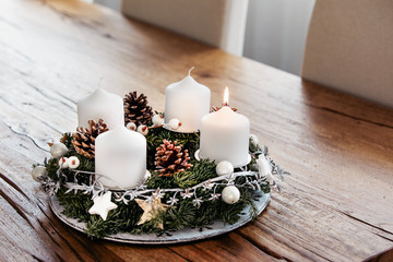 Lighting the first candle on the Advent Wreath on the first Sunday in December to celebrate the beginiing of Christmas holidays in Switzerland