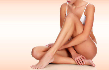 Young woman with slim body and smooth clean skin. Laser hair removal concept