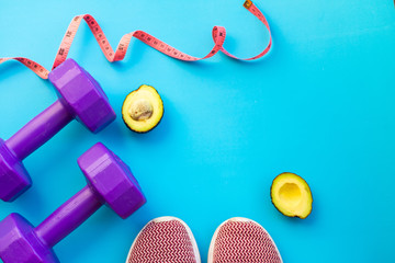 Fitness equipment dumbbells on color background. Flat lay.