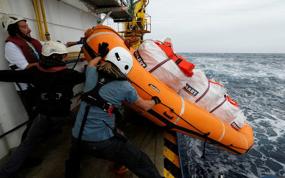 Crew members launch a raft carrying life jackets off the migrant search and rescue ship Sea-Watch 3 during a training exercise in the central Mediterranean