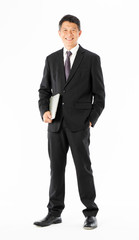 Business man in black suit standing and holding laptop