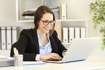 Happy office worker with eyeglasses working online