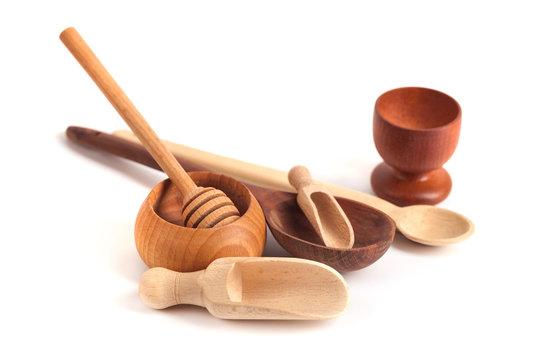 Set of wooden kitchen utensils isolated on white background
