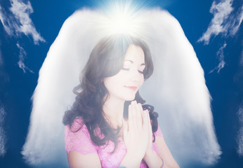 Beautiful young girl praying, protected by a guardian abstract angel