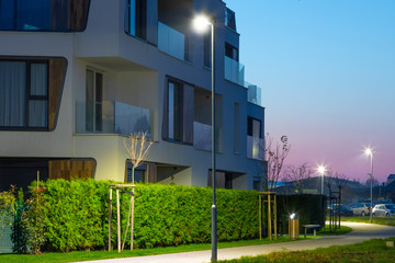 night street with modern appartment house and LED street lights Fotomurales