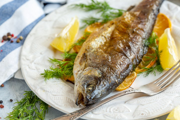 Baked lake trout with lemon and dill.