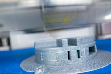 Close up of 3d printing. 3d printer printing objects form plastic filament