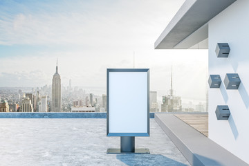 Empty white ad billboard on rooftop