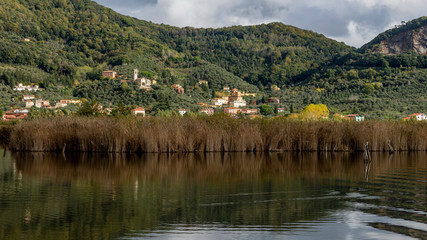 The characteristic village of Massaciuccoli seen from the homonymous lake, Lucca, Tuscany, Italy