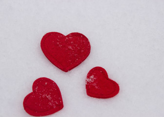 red hearts on snow background