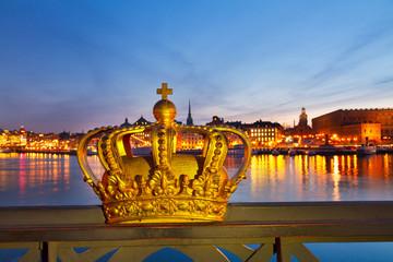 Royal crown and Stockholm skyline at night, Sweden