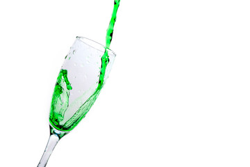 Green liquid is filled in a transparent glass on an isolated background.