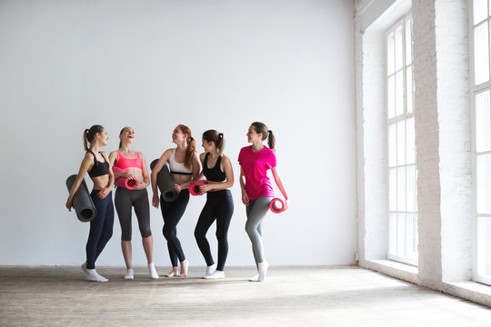 Happy group of fit women at the gym.
