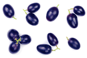 blue grapes isolated on the white background. Top view. Flat lay pattern
