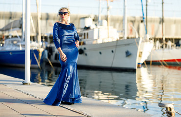 Portrait of adult fashionable elegant woman at the yacht