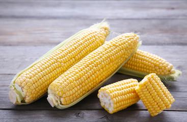 Fresh corn on a grey wooden background
