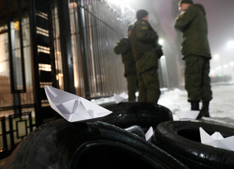 Paper boats are seen placed during a protest against the seizure by Russian special forces of three of the Ukrainian navy ships in the Black Sea, in front of the Russian embassy in Kiev