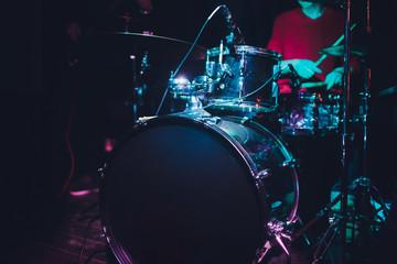 Modern drum set shot in smoky dark studio.