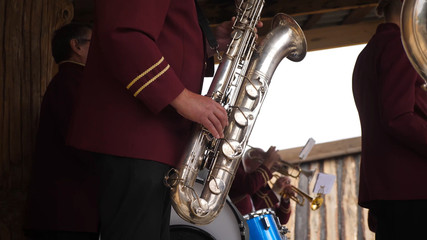 Close up of a musician playing his saxophone with his band