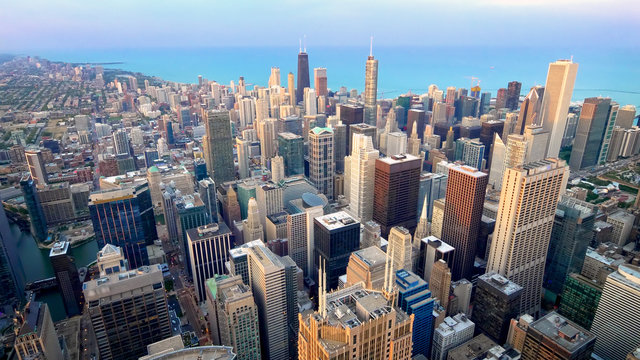 Aerial View of Chicago City Skyline and Lake Michigan (logos blurred)