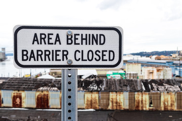 Area behind barrier closed sign with building