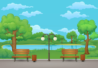 Summer day in the park . Benches, trash cans and street lamp on an asphalt park trail with lush green trees and bushes. Green meadow, lake and blue sky with clouds on the background.