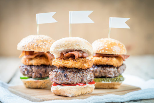 three selection of beef patty mini sliders burger sharing flags onions bacon cool