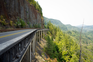 Bridge on stilts on the slope of the cliff above the precipice in Columbia River Gorge
