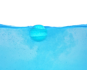 Wall Mural - Bath bomb in water on white background