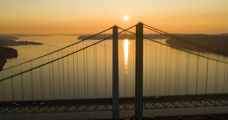 Sun Heads for the Horizon over Tacoma Narrows Bridges