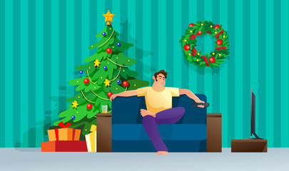 Man watching tv while sitting on couch. Christmas living room.