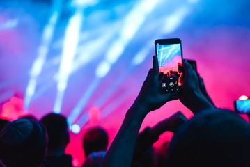 spectators at a concert phone close-up live broadcast