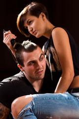 Young punk girl cuts her boyfriend